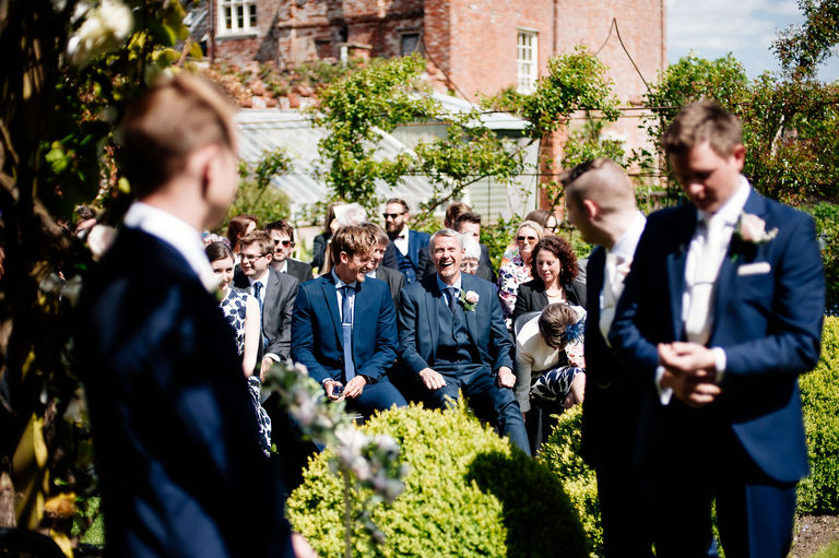 Guests at outdoors wedding ceremony