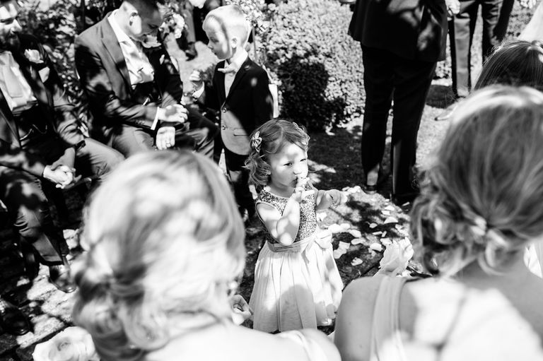 Funny flower girl at a wedding