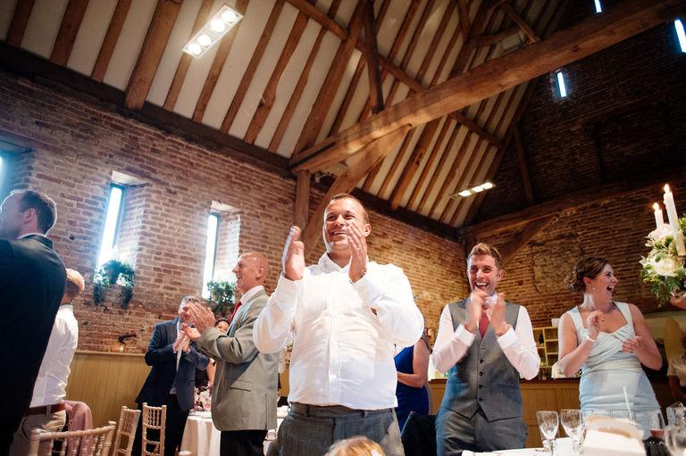 Wedding guests applaud speeches