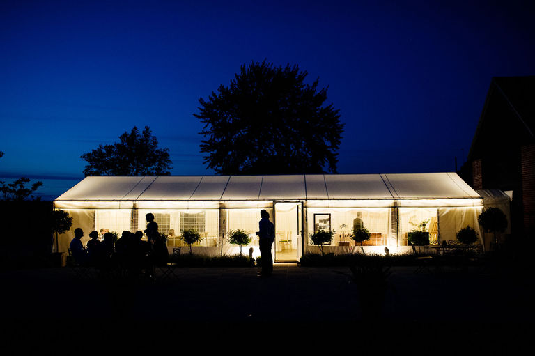 Wedding marquee lit up at night