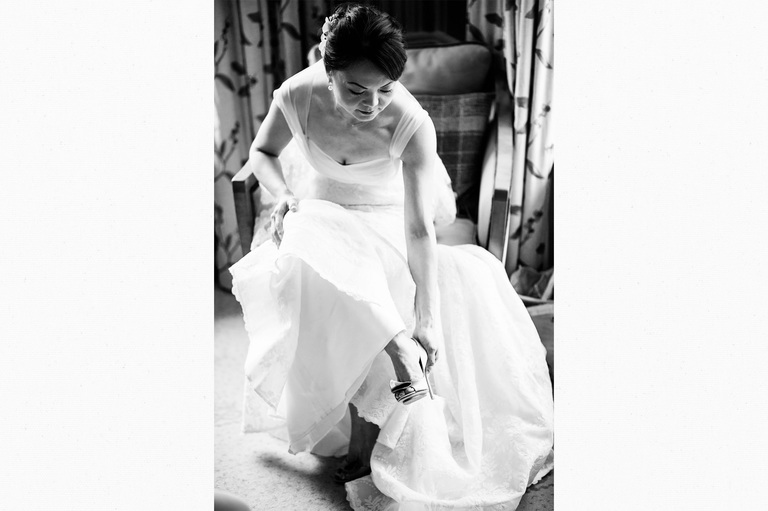 Bride putting her shoes one