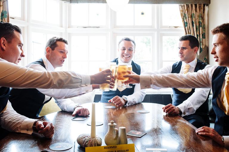 Groomsmen in pub before wedding
