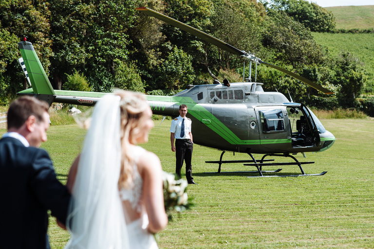 Bride and groom wedding helicopter surprise