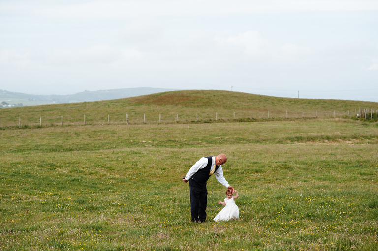 Father of the groom with granddaughter