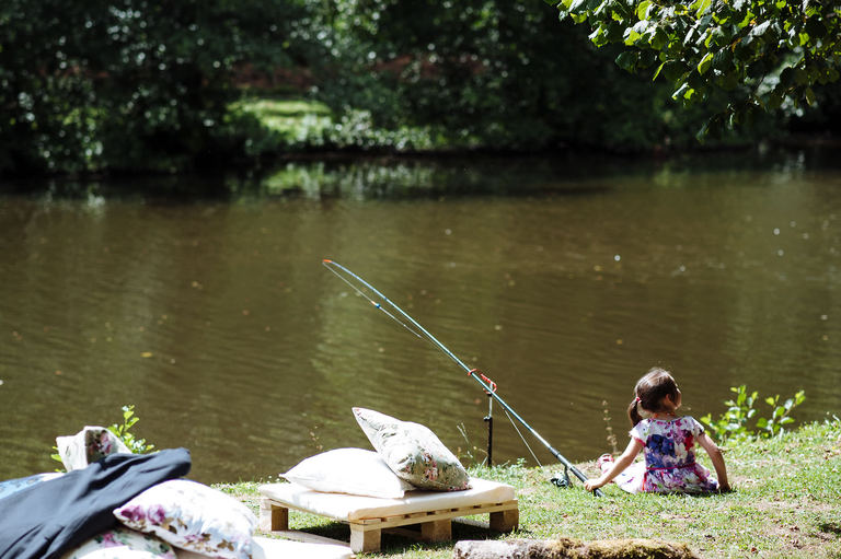 Little girl at a wedding fishing