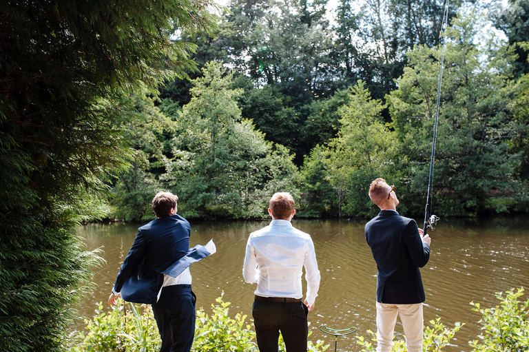 Groom and friends fishing