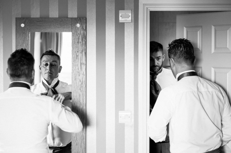 Groom getting ready at Eaves Hall