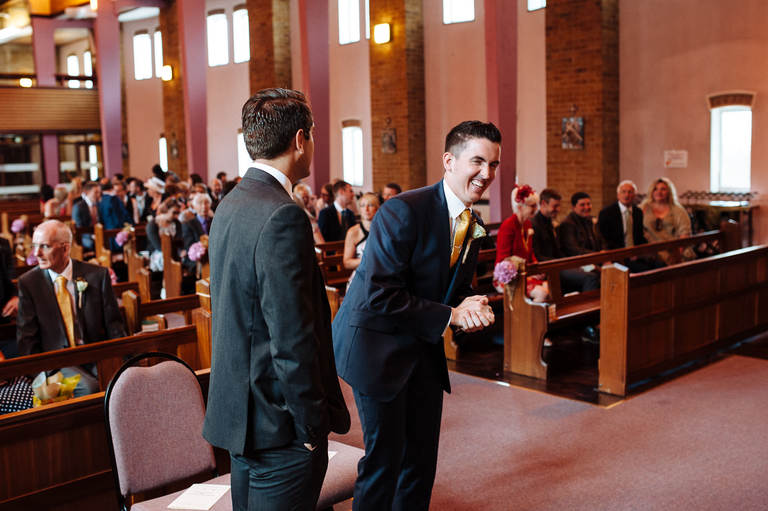 Groom and best man joking