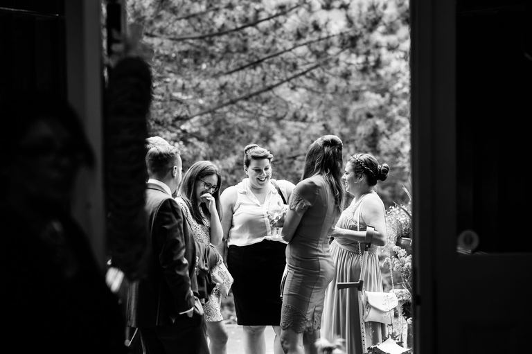 Guests laughing together at a wedding