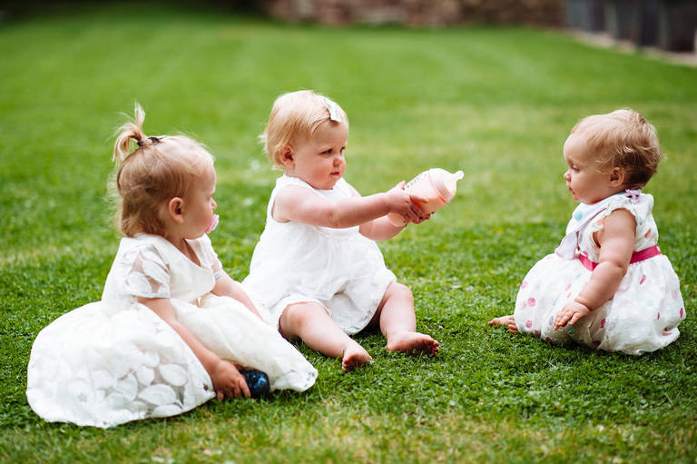 Babies playing together at a wedding