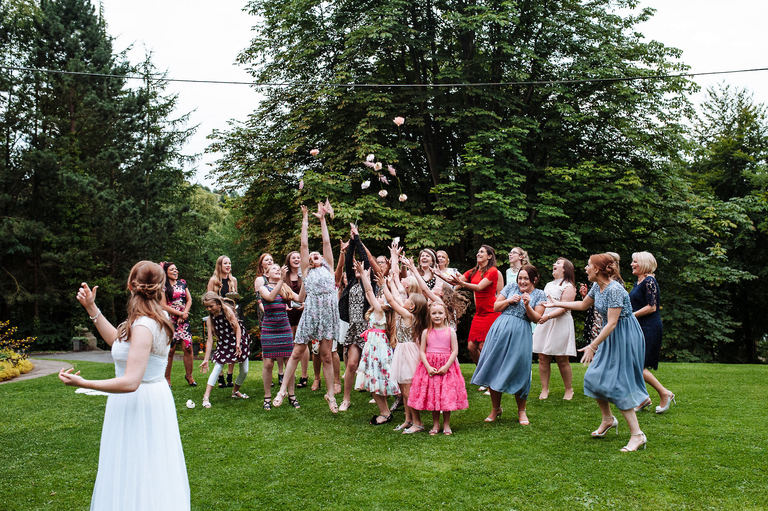 Separating bouquet toss at a wedding
