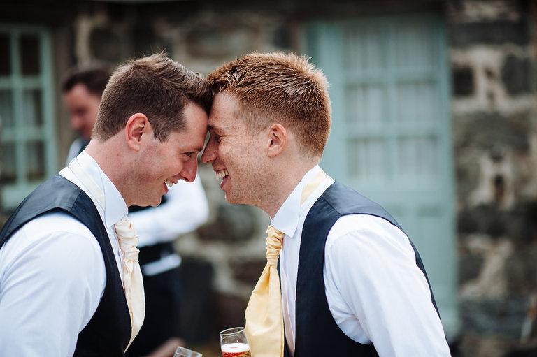 groom joking with best man