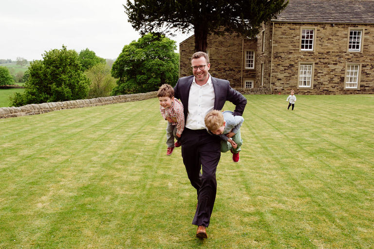 wedding guest carrying little boys