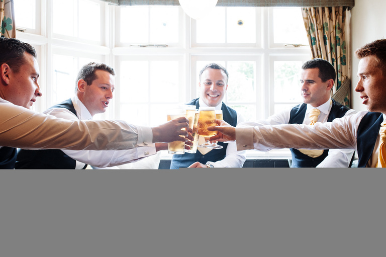 groomsmen drink a toast