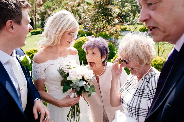 elderly wedding guests laughing