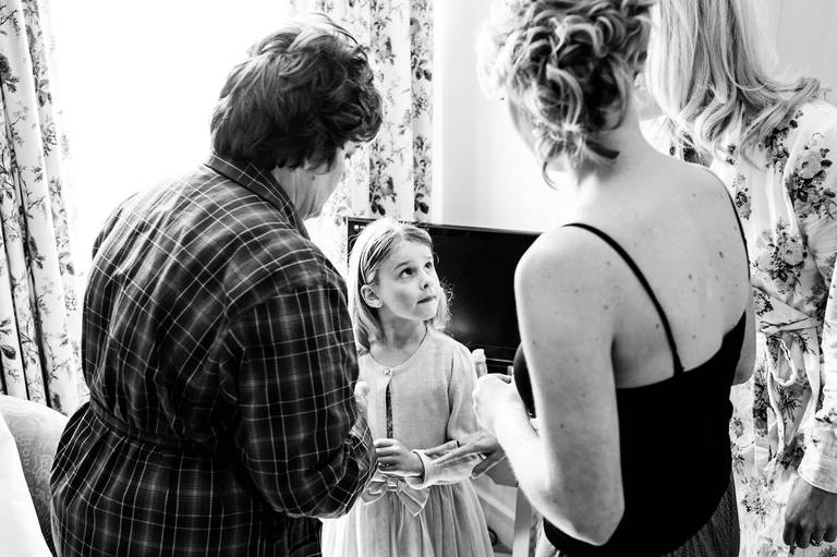 little girl looking at bride