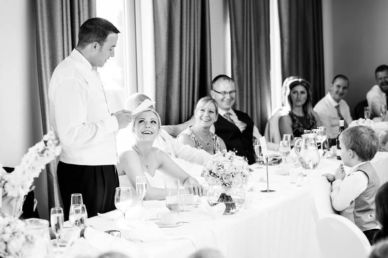 bride looks lovingly at her groom