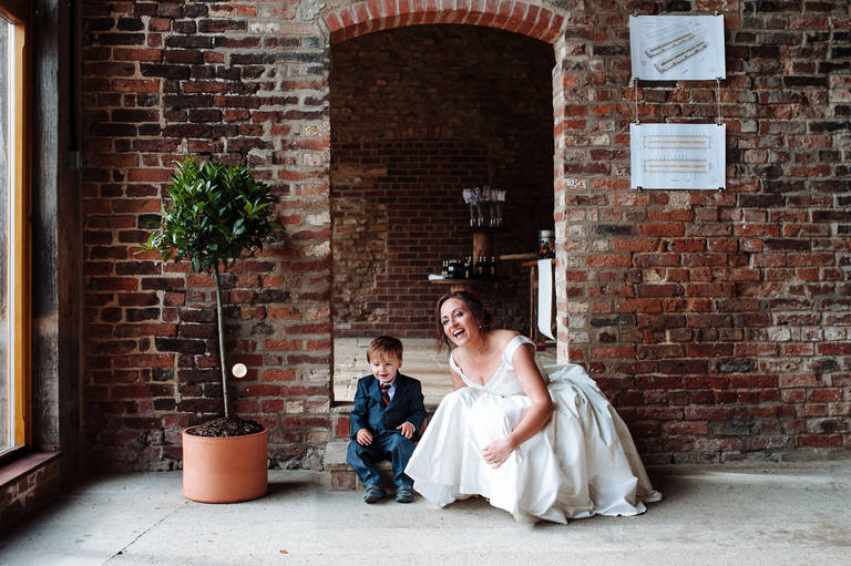 bride plays ball with page boy
