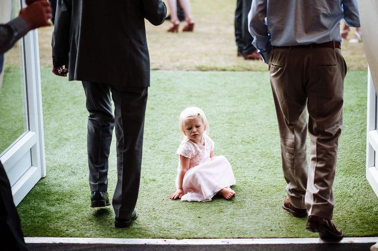 unhappy little girl at wedding
