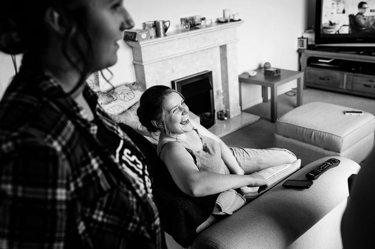 bridesmaid relaxing and laughing