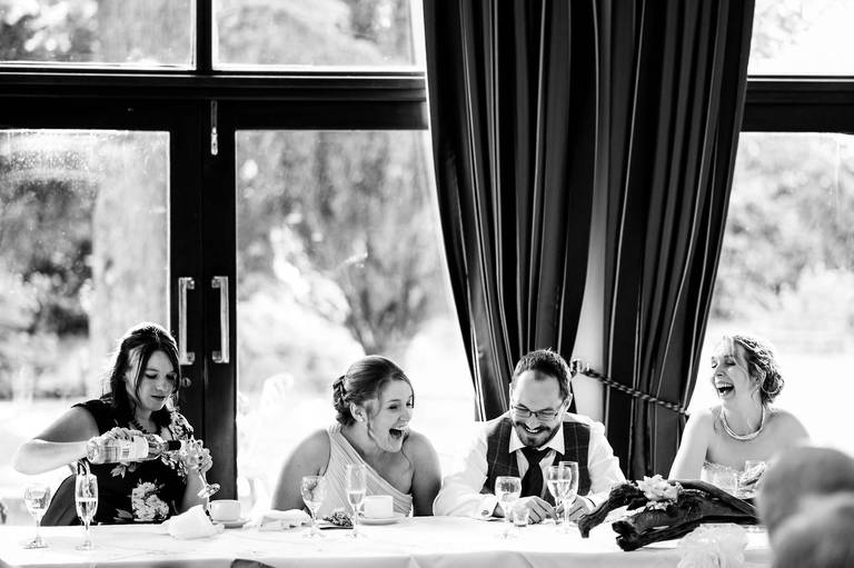 groom laughing with guests