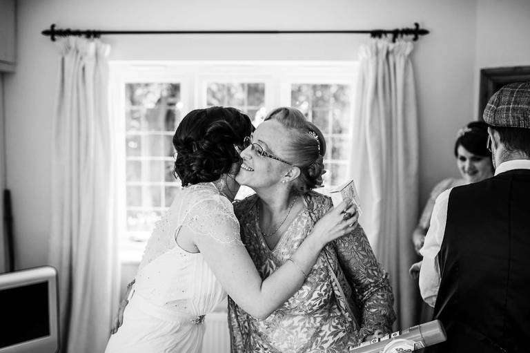 bride kisses her mum
