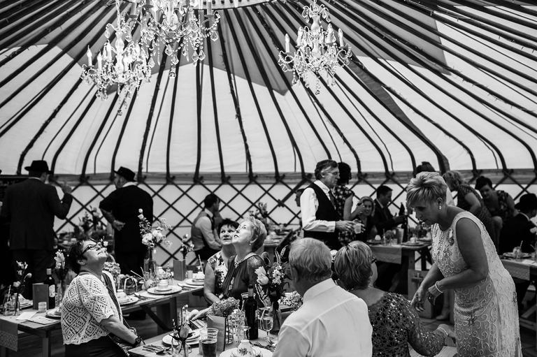 guests admiring the yurt's interior