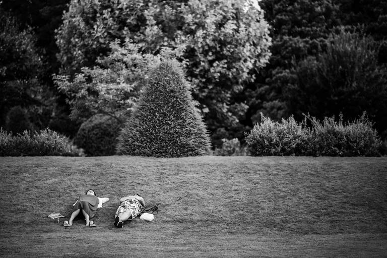 two guests relaxing on the grass