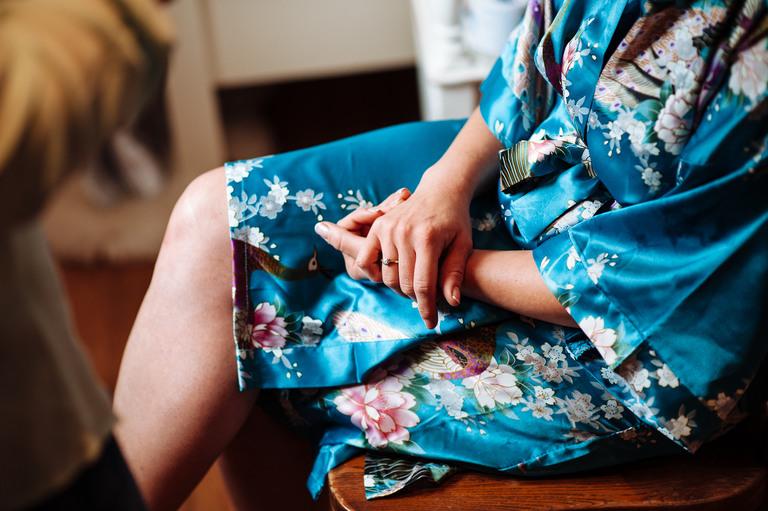 brides hands close up against kimono