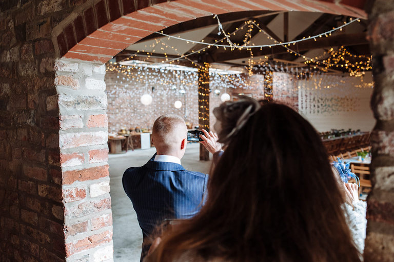guests taking photos of wedding venue