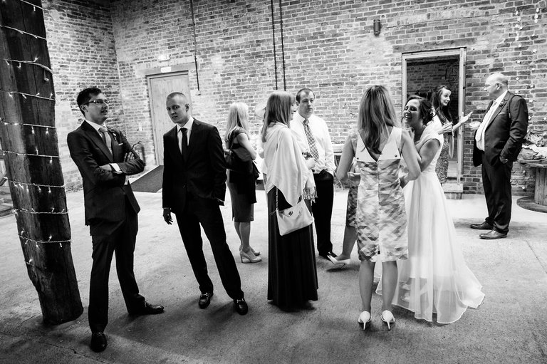 guests mingling in barn venue