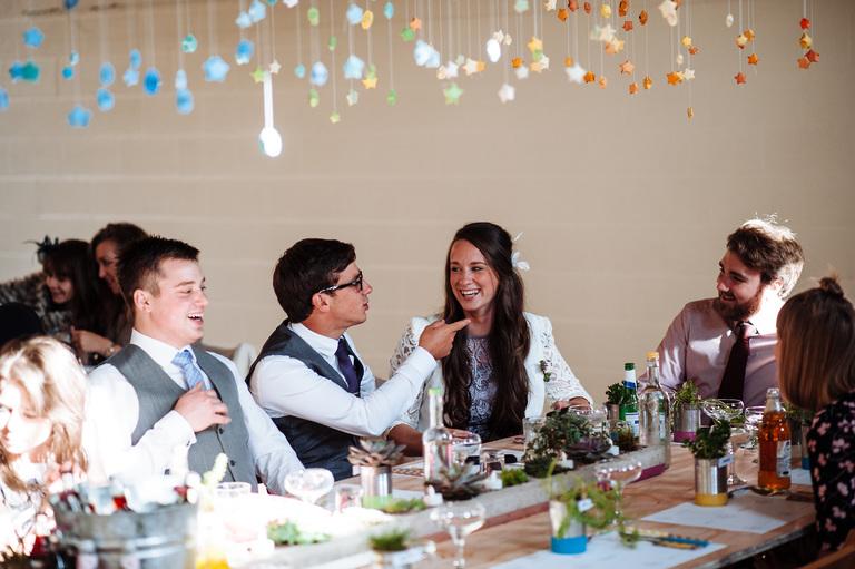 guests having fun at wedding table