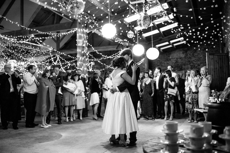 fairy lights first dance in a barn