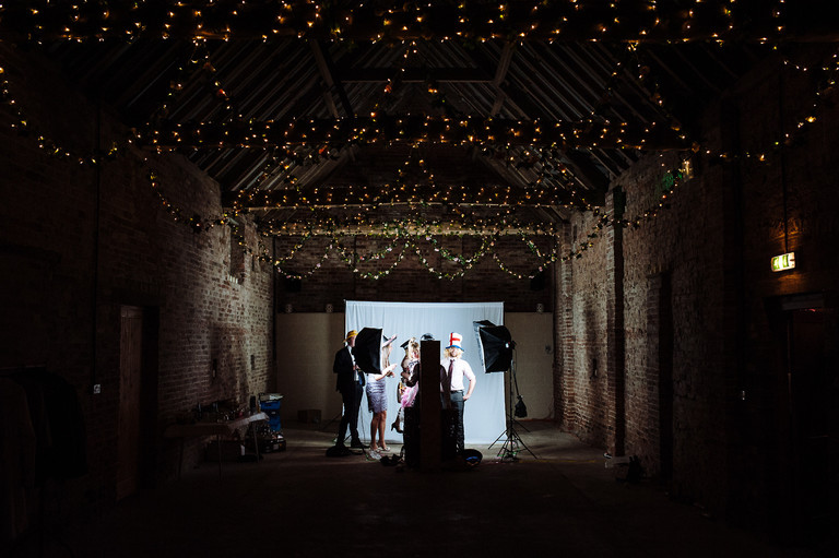 guests play with the photobooth in a barn