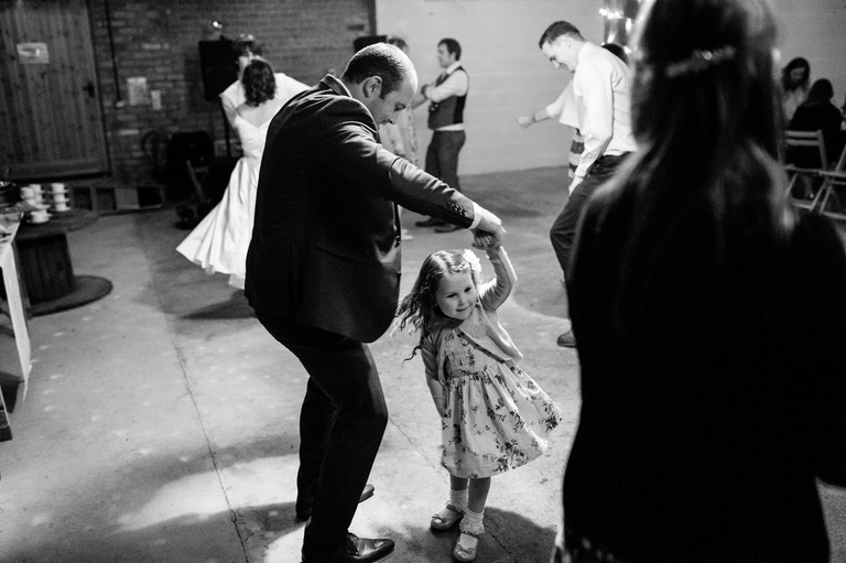 dad dances with his young daughter