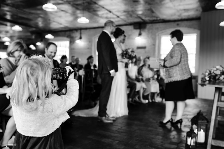 young wedding guest taking photos