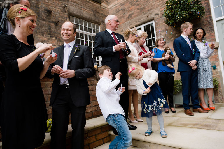 wedding guests with bubbles