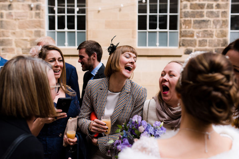 friends of the bride laughing