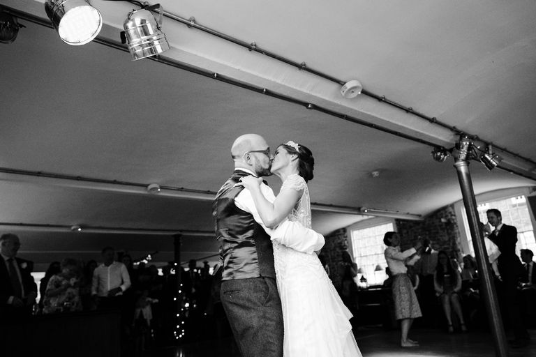 newlyweds kissing on the dance floor