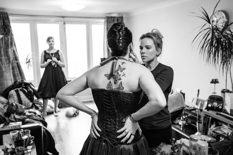 bride having make up done back tattoo