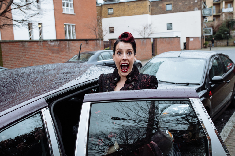 excited bride getting into her wedding car