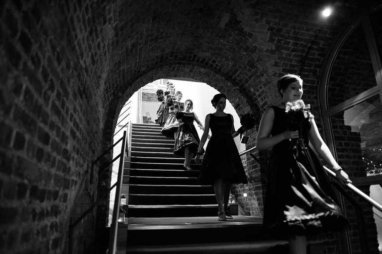 bride and bridesmaids walking down stairs