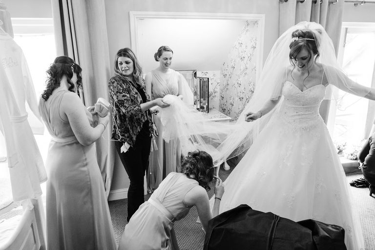 final touches to the wedding dress