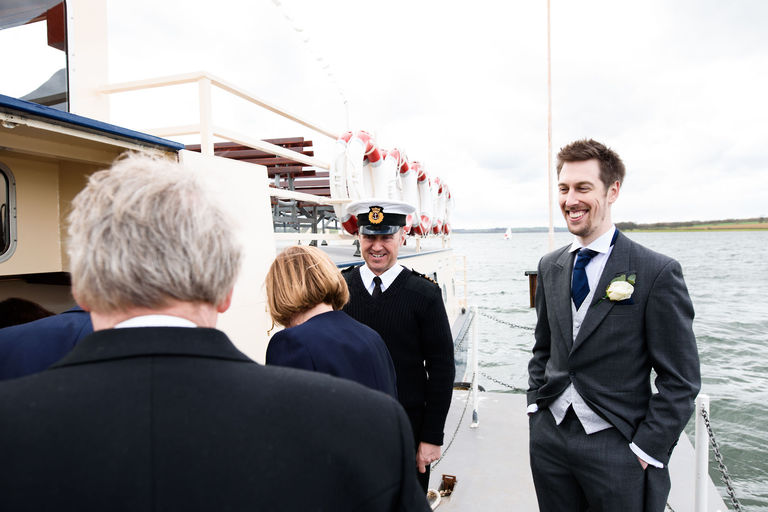best man and captain greeting guests