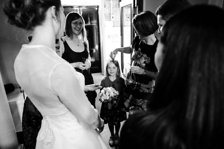 young girl admiring the bride