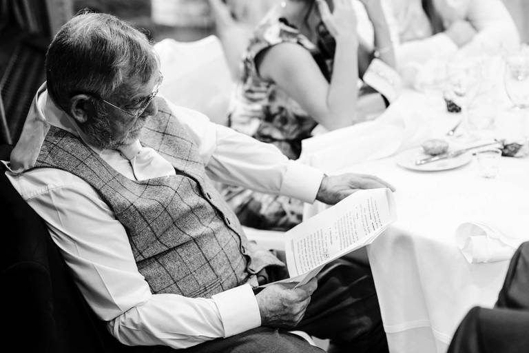 father of the bride reading his speech