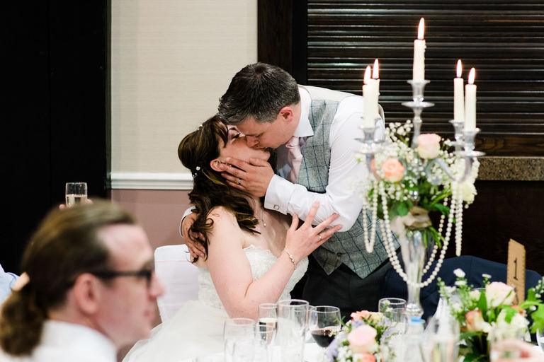 couple kissing after speeches