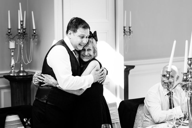 groom hugs his mum