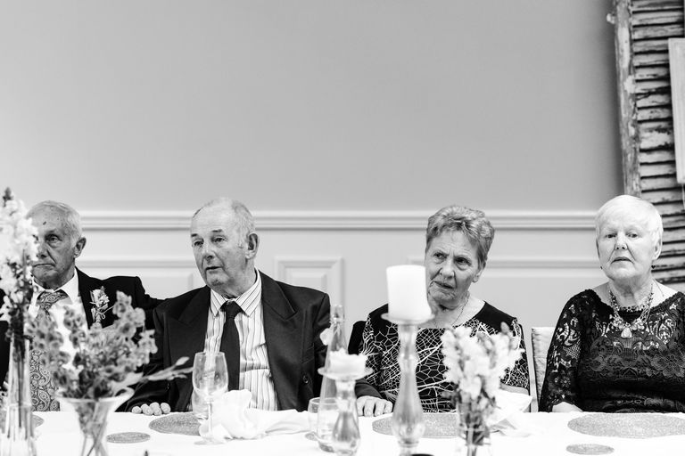 four wedding guests looking bored