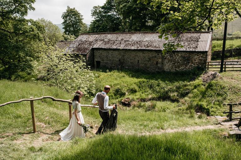 bride and groom exploring outdoors venue